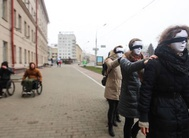 Sighted people take a blindfold walk around Minsk, trying to live as blind people